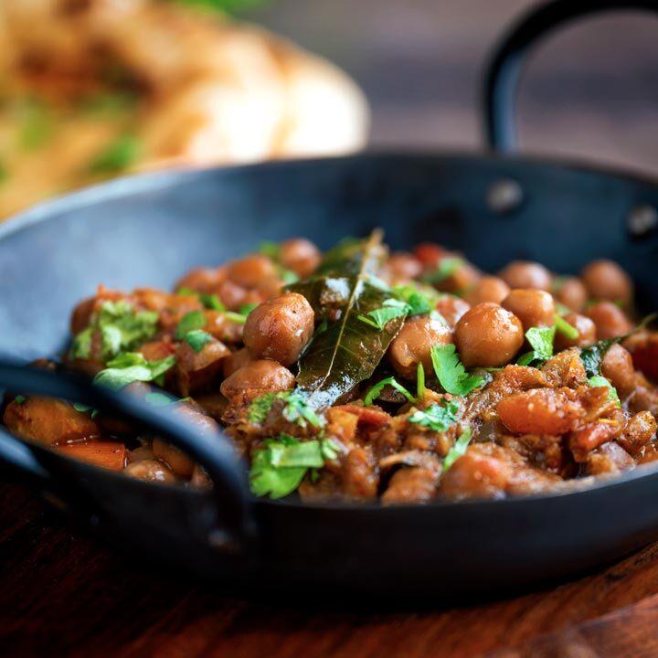 Punjabi chole masala curry or chana masala served in an iron karai.