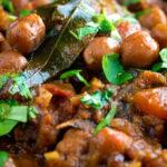 Close up vegan Punjabi chole masala curry or chana masala featuring a title overlay.