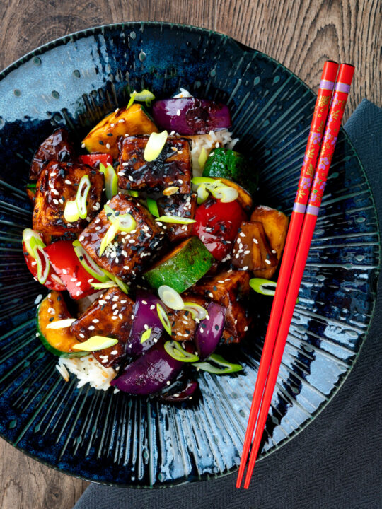 Overhead vegan sweet and sour tofu loaded with vegetables.