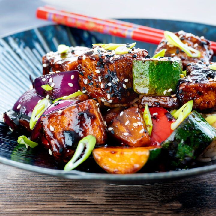 Vegan sweet and sour tofu loaded with vegetables and pineapple.