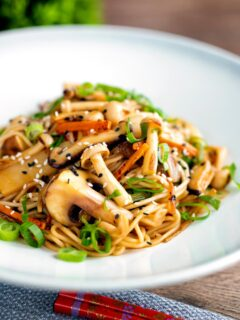 Vegetarian mushroom chow mein noodles served with shredded spring onion.