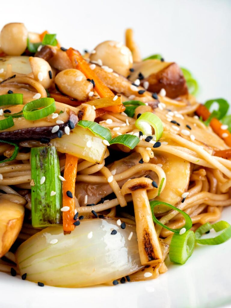 Close up vegetarian mushroom chow mein noodles using 3 types of mushroom.