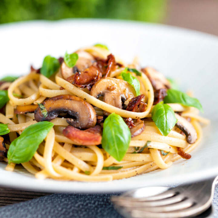 Bacon and mushroom pasta with sun dried tomatoes and fresh basil.