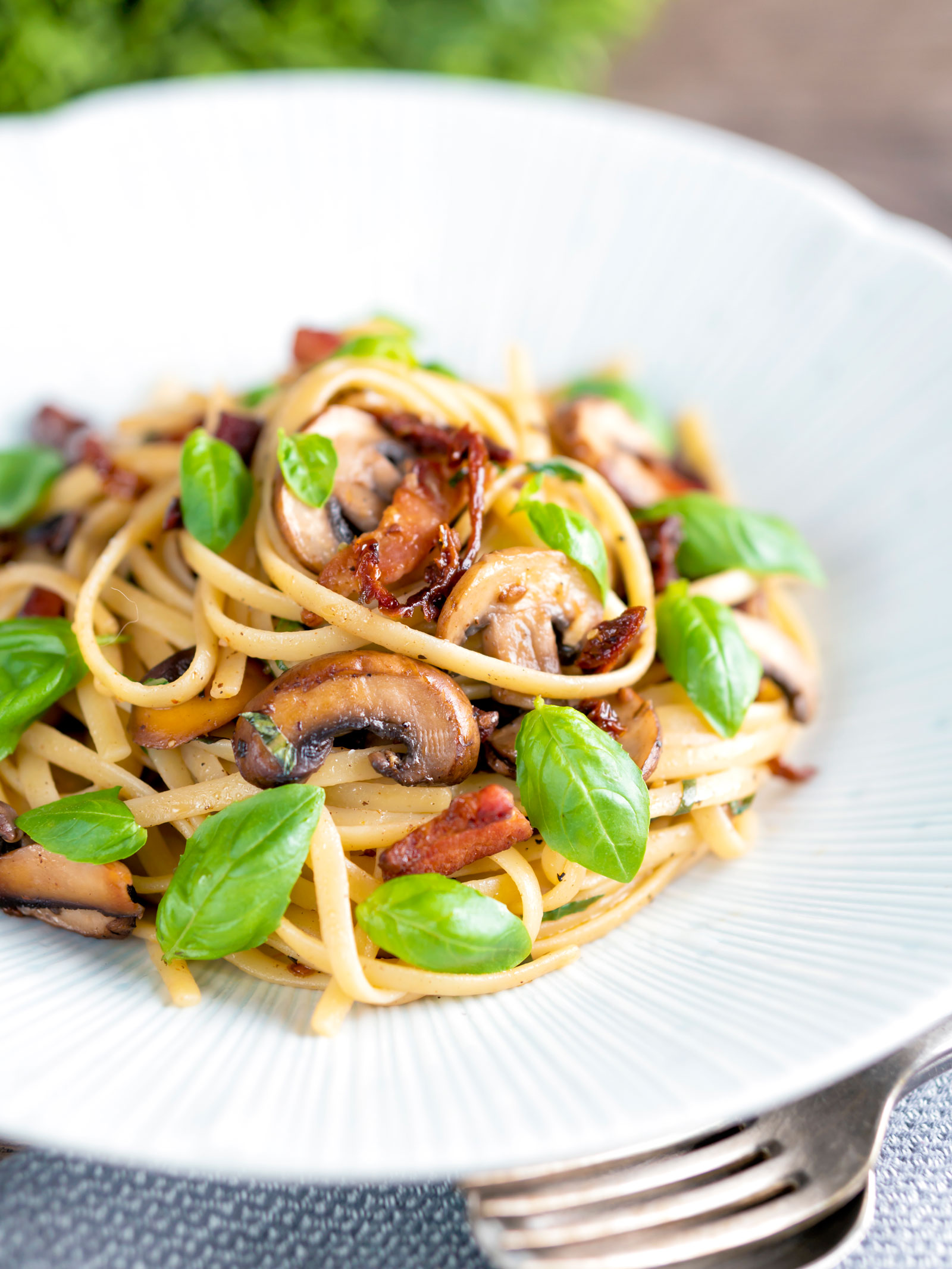 Bacon and mushroom pasta with sun dried tomatoes.