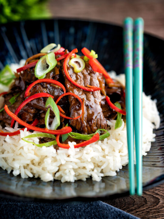 Beef in oyster sauce Chinese takeaway stir fry served with rice.