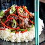 Beef in oyster sauce Chinese takeaway stir fry served with rice featuring a title overlay.