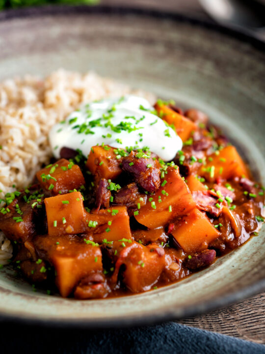 Butternut squash chilli served with brown rice, and sour cream.