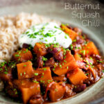 Butternut squash chilli served with brown rice, and sour cream featuring a title overlay.