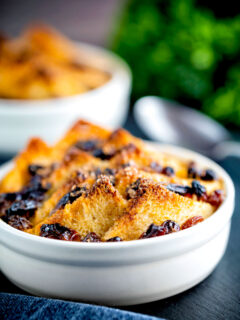 Individual bread and butter puddings served in creme brulee bowls.