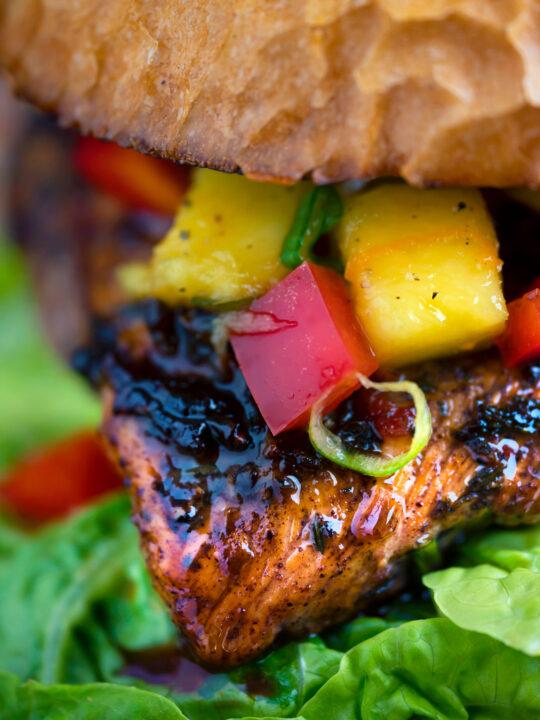 Close up Jamaican jerk chicken burger with a mango salsa.