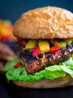 Jamaican jerk chicken burger with a mango salsa and crispy lettuce.