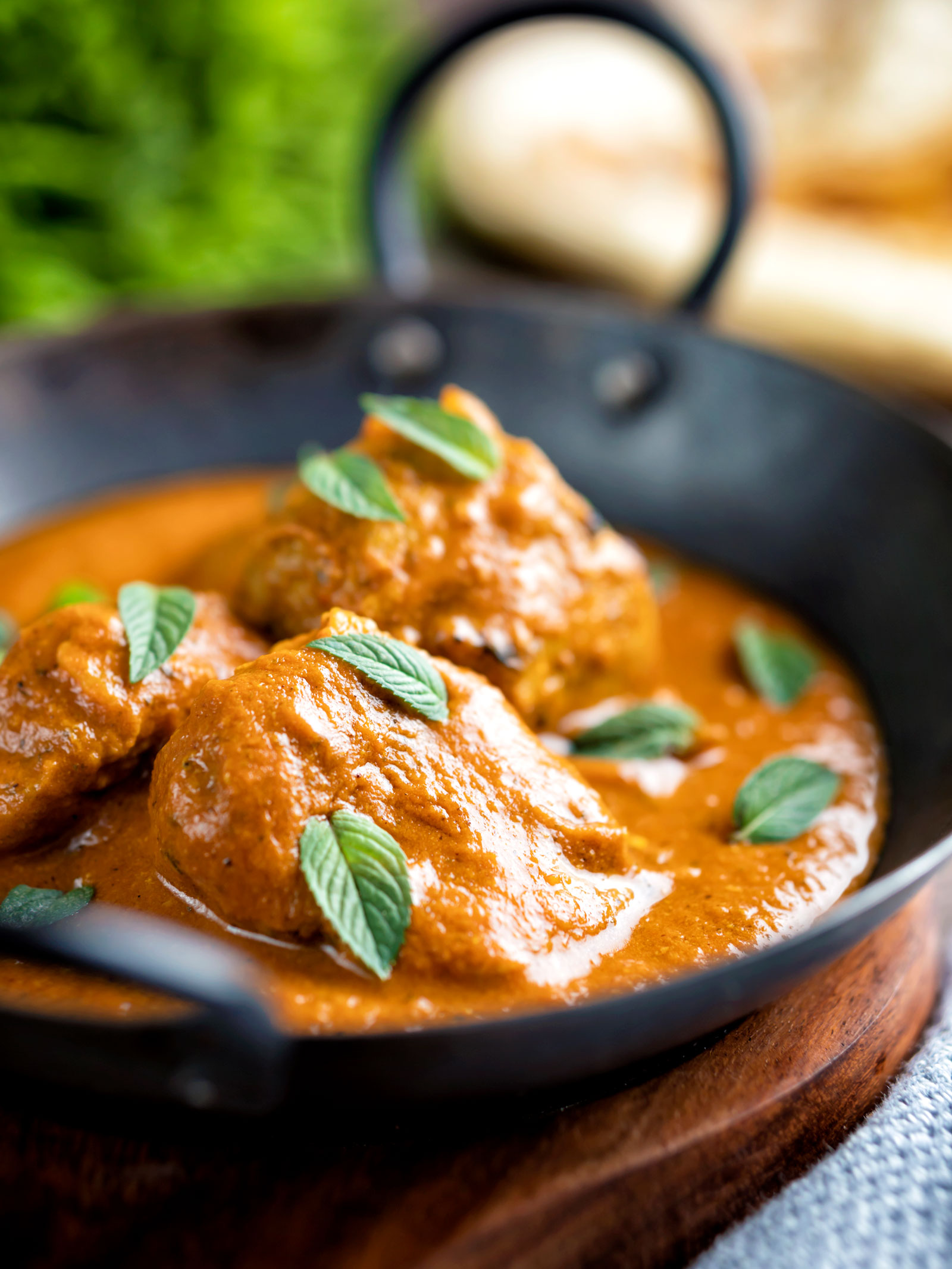 Indian lamb tikka masala curry served with a naan bread.