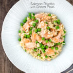Overhead salmon risotto with green peas and fennel seeds featuring a title overlay.