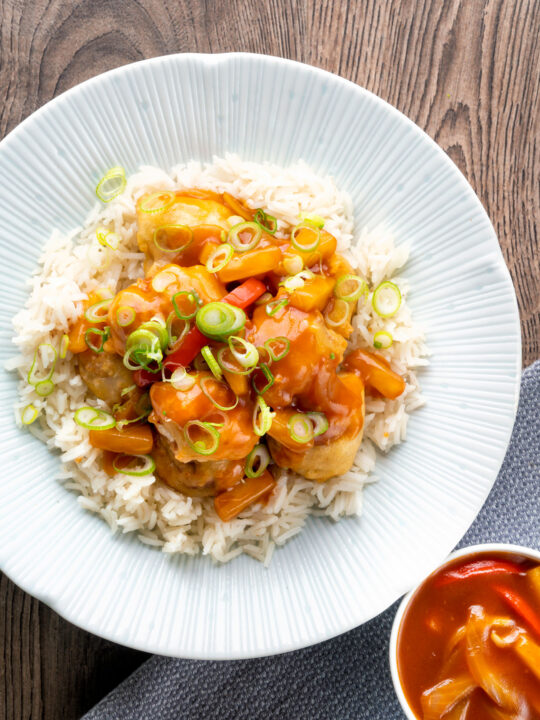 Overhead crispy sweet and sour pork balls served with rice.