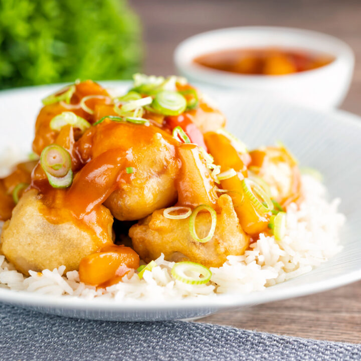 Crispy Chinese sweet and sour pork balls served with white rice.