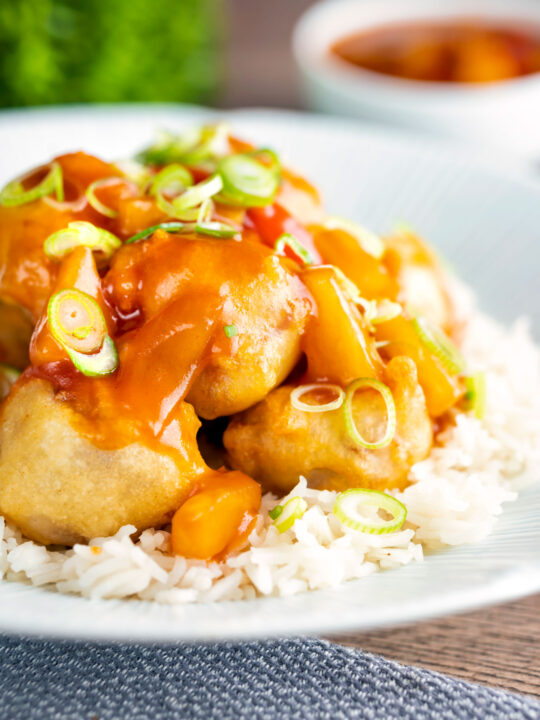 Crispy Chinese pork balls swerved with sweet and sour sauce on rice.