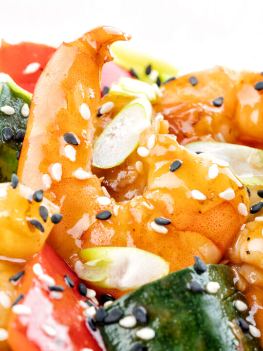 Close up sweet and sour prawns or shrimp with sesame seeds.