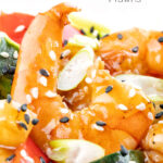 Close up sweet and sour prawns or shrimp with sesame seeds featuring a title overlay.