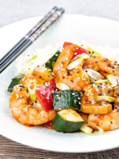 Sweet and sour prawns or shrimp with vegetables and rice.