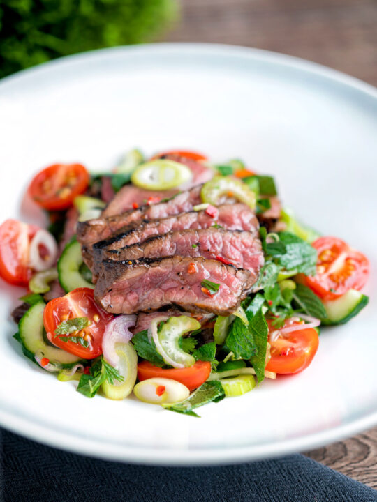 Thai beef salad with rare beef, tomatoes, mint, chilli, shallot, celery and cucumber.
