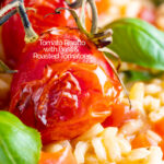 Close up tomato risotto with basil and roasted tomatoes featuring a title overlay.
