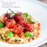 Tomato risotto with basil and roasted tomatoes served in a white bowl featuring a title overlay.