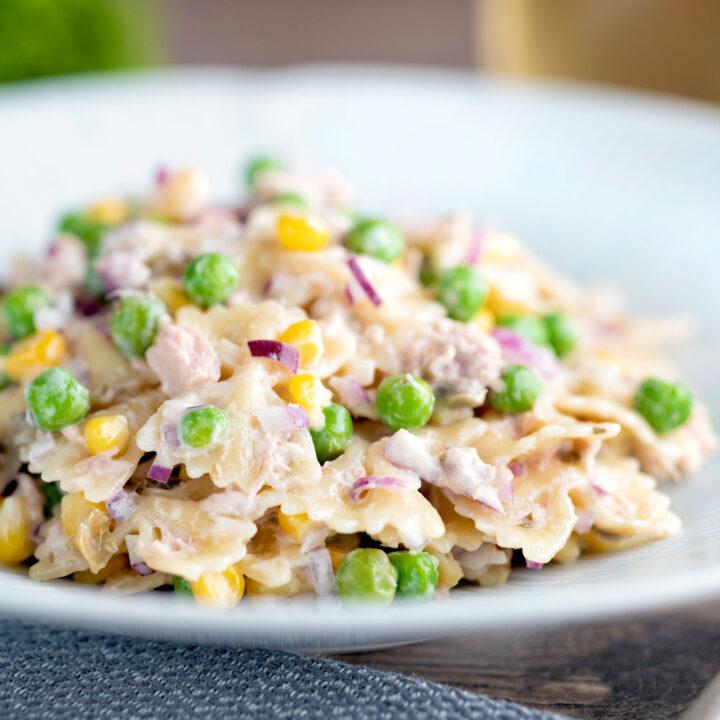 Tuna pasta salad with creamy mayo peas, corn and red onion.
