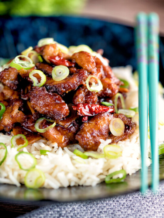 General Tso's chicken fakeaway recipe served on white rice.