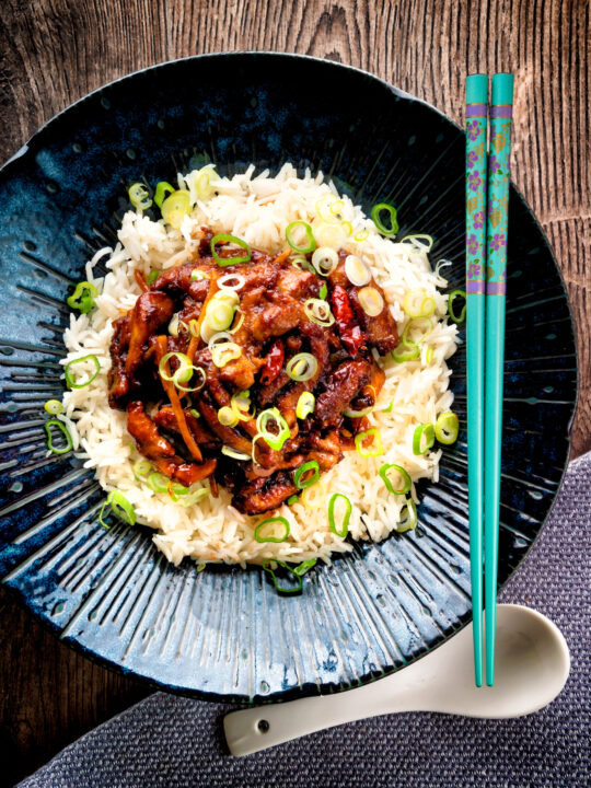 Overhead General Tso's chicken fakeaway recipe served on white rice.