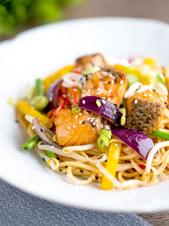 Salmon stir fry with egg noodles and vegetables.