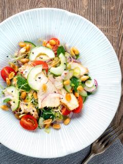 Overhead crunchy & spicy Thai chicken salad with peanuts.
