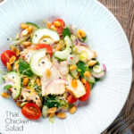 Overhead crunchy & spicy Thai chicken salad with peanuts featuring a title overlay.
