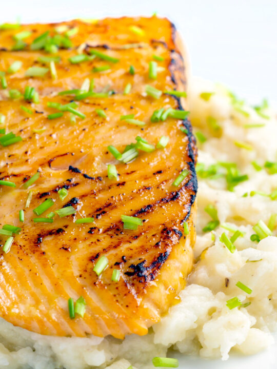Honey mustard salmon fillet served on celeriac mash with snipped chives.