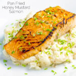 Pan fried honey mustard salmon served on celeriac mash featuring a title overlay.