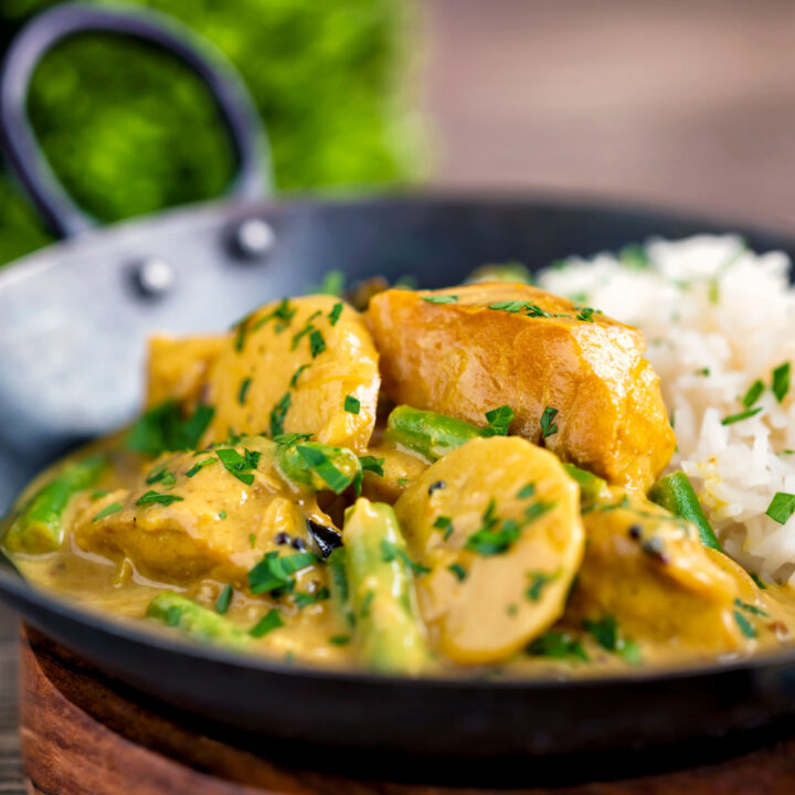 Keralan fish curry with coconut milk featuring green beans and potato and basmati rice.