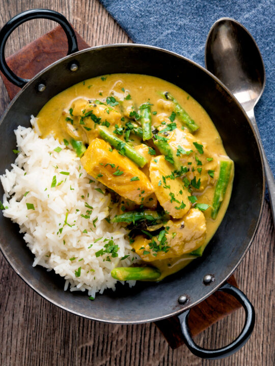 Keralan fish curry with coconut milk featuring green beans and potato.