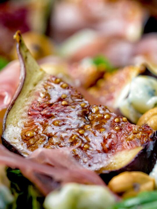Close up roasted figs served in a salad.