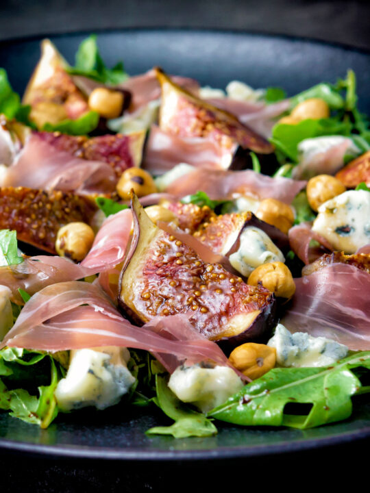 Roasted figs with prosciutto ham, rocket, blue cheese and hazelnuts.