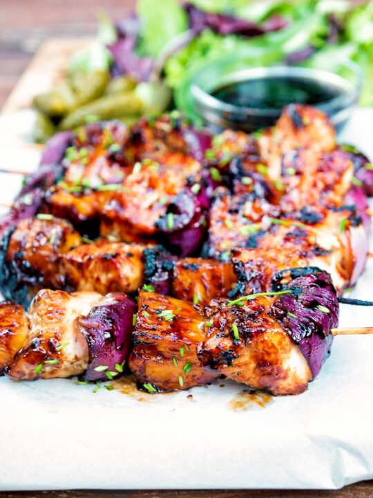 BBQ chicken skewers with pineapple and red onion with a sweet and sour glaze.