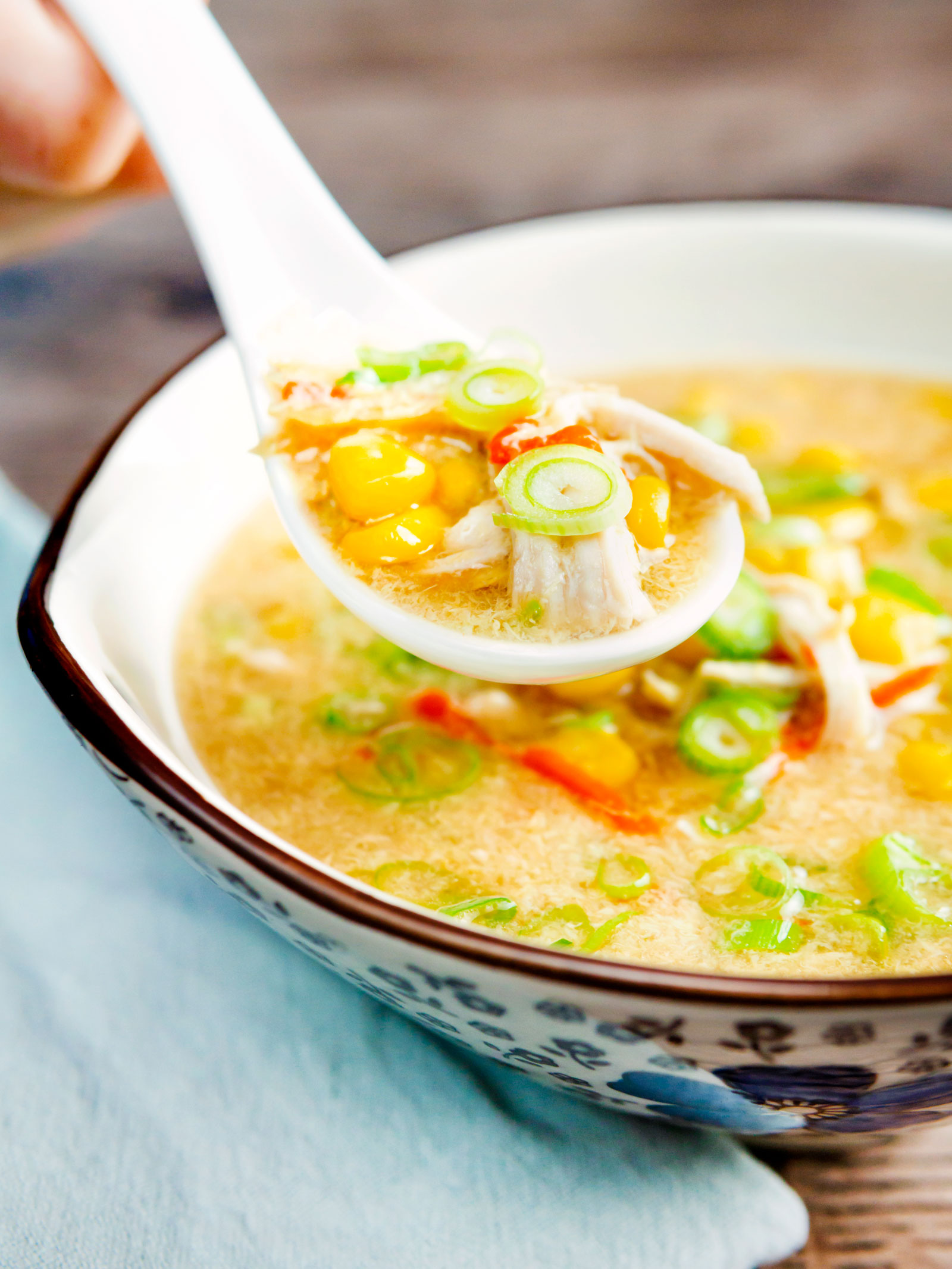 Chinese style chicken and sweetcorn soup on a spoon.