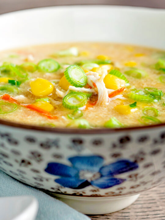 Chinese style chicken and sweetcorn soup served in a flower decorated bowl.
