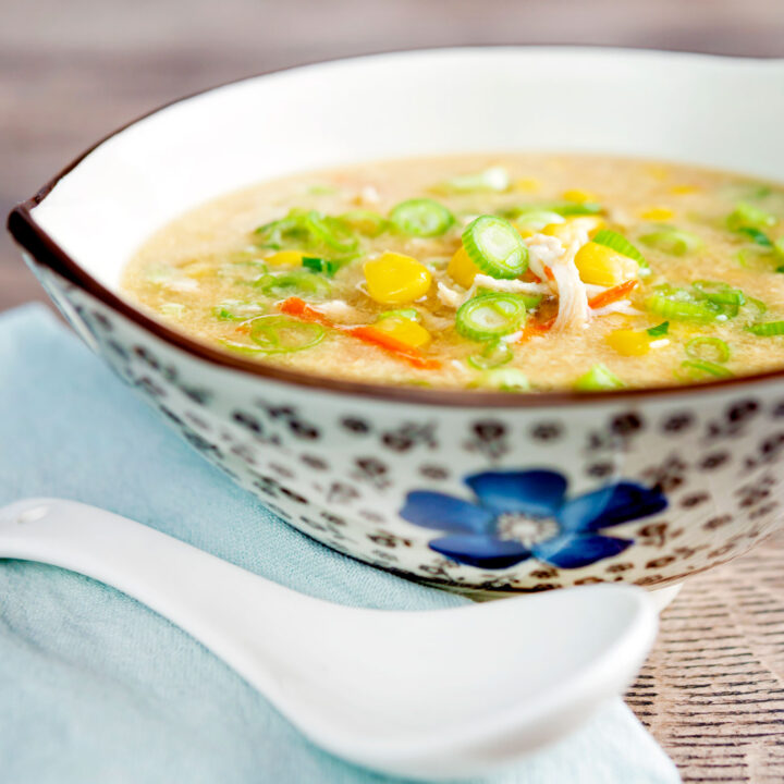 Chinese style chicken and sweetcorn soup served in a stylised flower decorated bowl.