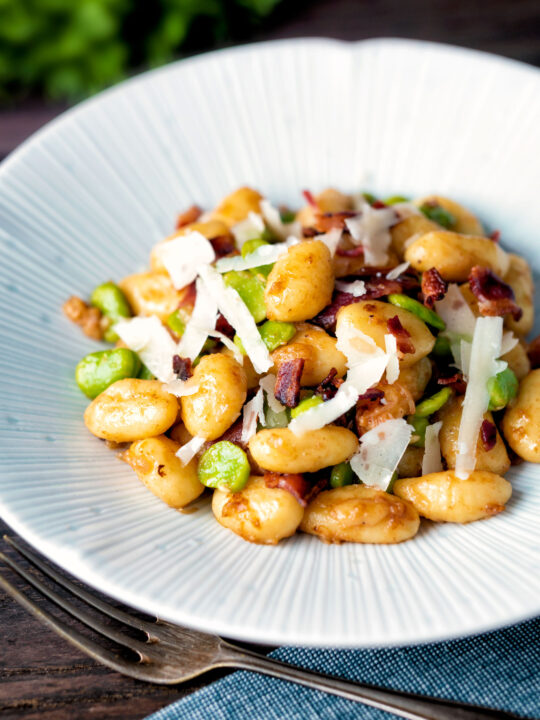 Pan fried gnocchi with bacon, broad beans and parmesan shavings.