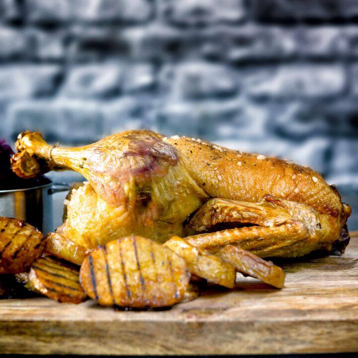 Whole crispy roast duck with duck fat potatoes.