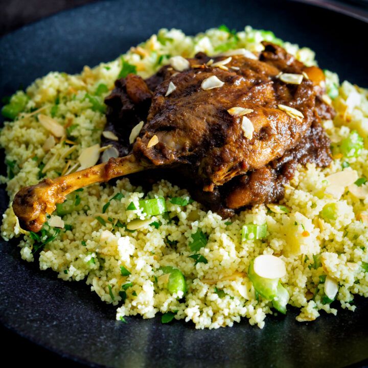 Slow cooked tamarind duck leg with a date and almond sauce served with couscous.